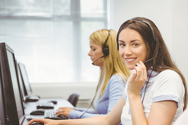 Image of call centre staff talking on headsets with callers